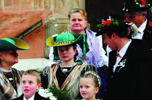 The guest of the peasants wedding gather in front of the church of Castelrotto