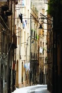 Narrow street in Old Town in Cagliari, Sardinia, Italy