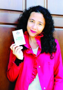 Marina Spironetti shows her brand new honorary passport of Seborga, which she purchased in a souvenir shop