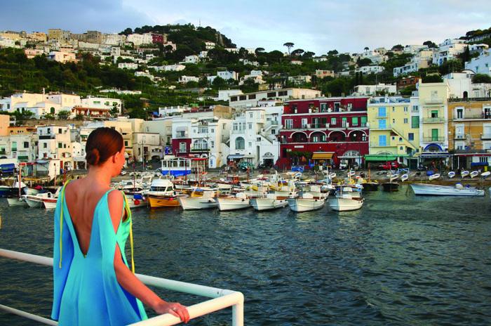 Glamorous partygoer arrives in Capri harbour