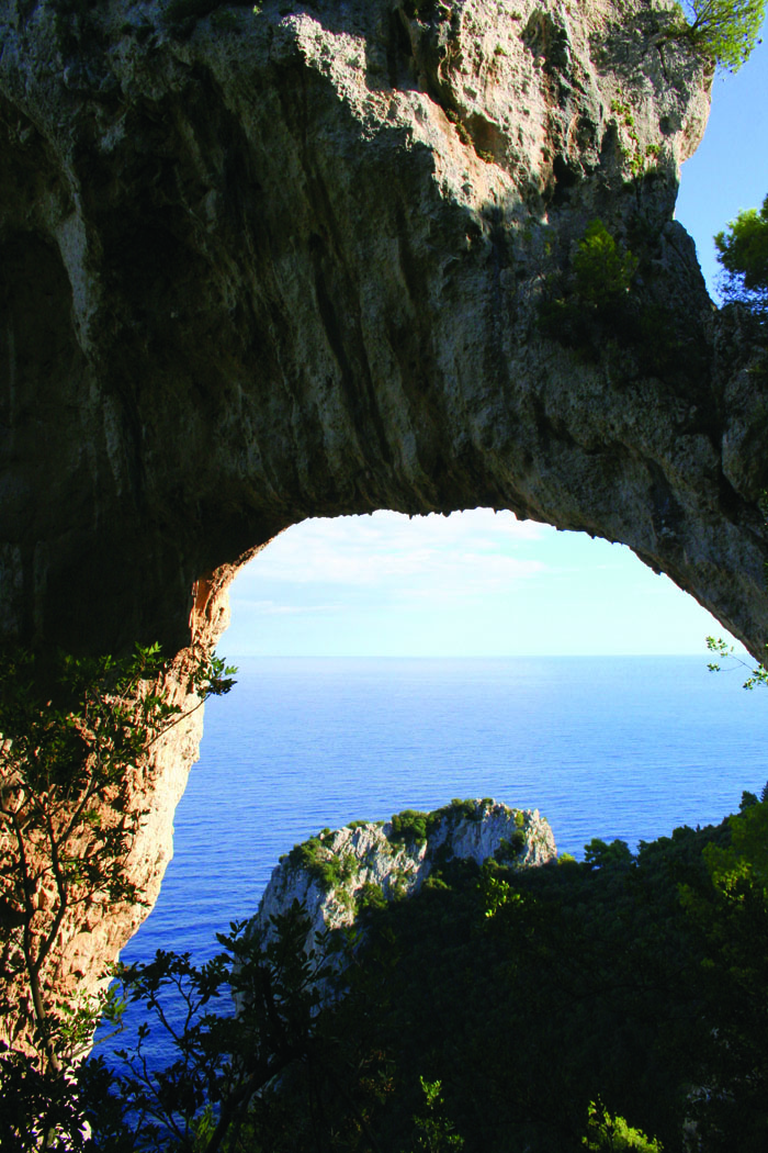 Natural arch climbing from the sea