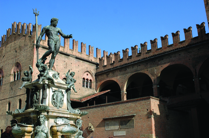 Neptune's fountain and the battlemented Palazzo di  Re Enzo Bologna Emilia Romagna Italy