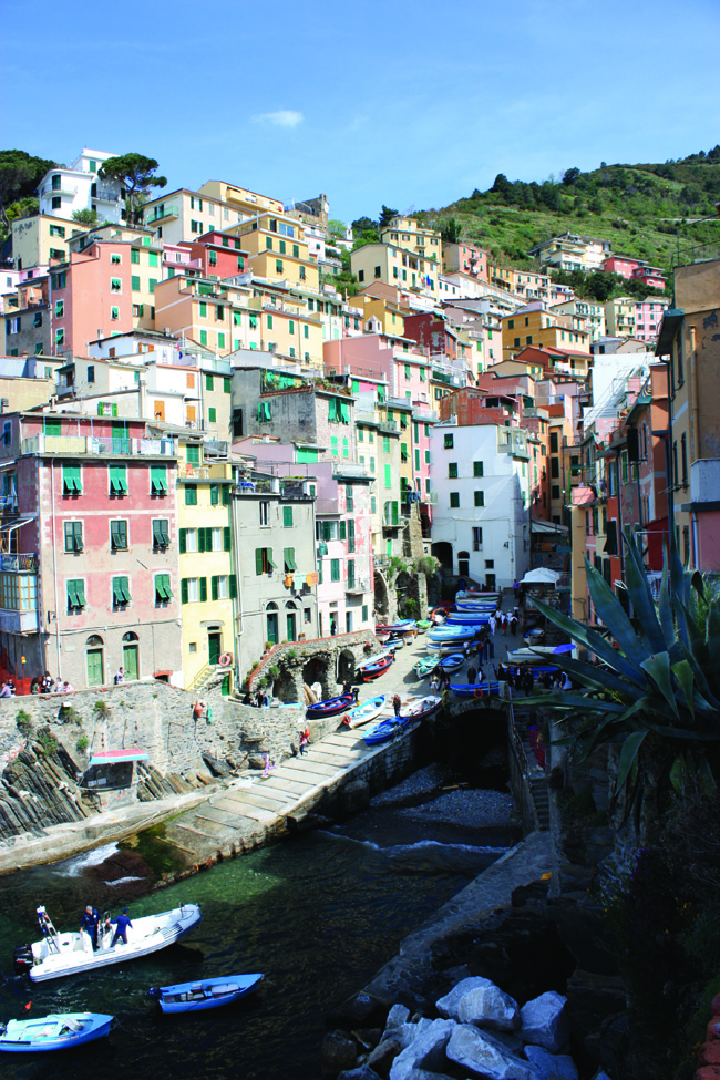 Tourists mingle with the boats on the quay at Riomaggiore