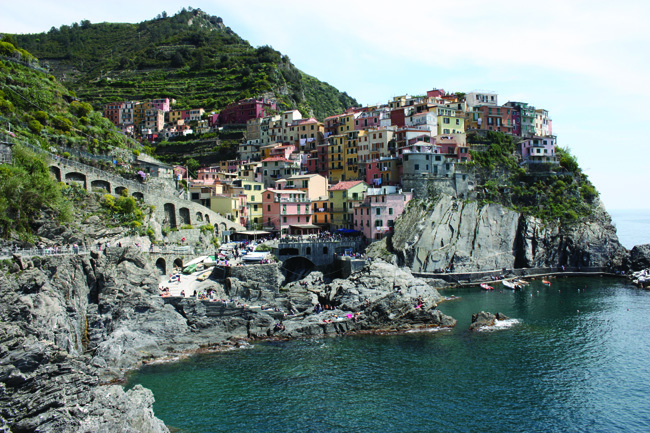 The houses of monterosso huddle on the rugged Ligurian cliffside