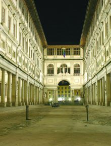 The Uffizi museum in Florence, Italy, by night.  Faces blurred by long exposure.