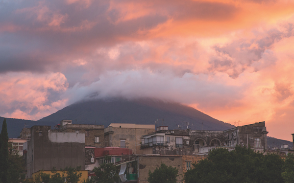 Vesuvius broods over Ercolano at dawn in Italy