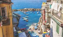 Picturesque Riomaggiore village with view of the sea, famous Cinque Terre, Italy.