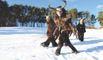 Krampus festival in a snowy field just outside Castelrotto, South Tyrol, Italy