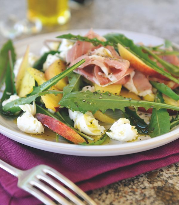 Parma ham, peach, mozzarella and dandelion leaf salad
