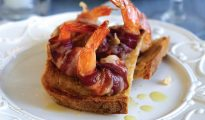 Pancetta-wrapped prawns on crostini